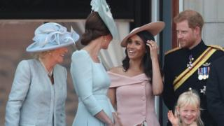 The Duchess of Cambridge wore an Alexander McQueen dress while the Duchess of Sussex wore Carolina Herrera