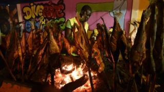 Fish is prepared during the annual Grill Festival on September 10, 2017 in Abidjan, a gastronomic fair bringing together thousands from various ethnic groups to the Ivorian capital