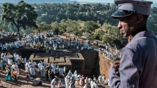 Ethiopian Orthodox pilgrims take part in the Christmas Eve celebration at Saint George Church in Lalibela, Ethiopia - Sunday 6 January 2019