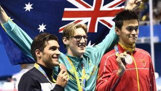 Gold medallist Mack Horton on the podium with silver medallist Sun Yang and bronze medallist Grabriele Detti, of Italy after the Men's 400m Freestyle Final