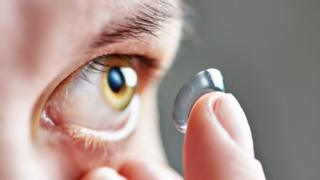 Putting in a contact lens