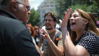 Anti-austerity protester argues in Athens with local man
