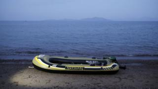 An abandoned rubber dinghy on a beach near the coastal town of Bodrum, Turkey - 16 August 2015