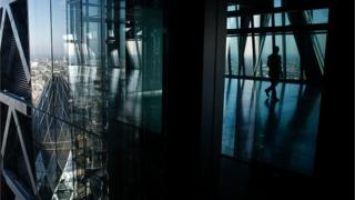 The glass windows of the Leadenhall Building, also known as the Cheesegrater, reflect the Gherkin