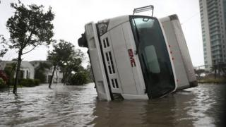 An overturned vehicle on a flooded street in Miami, Florida. Photo: 10 September 2017
