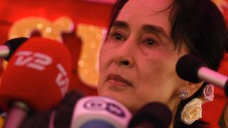 Aung San Suu Kyi speaks at a press conference from her residential compound in Yangon on November 5, 2015
