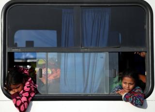 Migrants Isis Alexandra, aged 8 and Amanda Garcia, aged 6 from Honduras, part of a caravan of thousands from Central America en route to the United States, travel on a bus as they are transported to Juchitan from Santiago Niltipec, Mexico, October 30, 2018.
