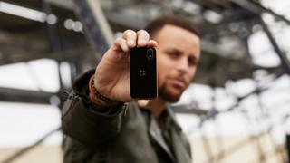 Palm phone held by Stephen Curry