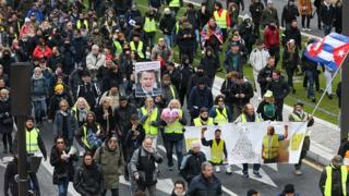 Yellow vest protesters march in Paris on November 16, 2019, to celebrate the first anniversary of the movement