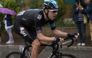 Bradley Wiggins cycling in the rain in Italy, May 2013
