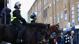 Police on horses line up outside the stadium prior to kick off during the match between Tottenham Hotspur and West Ham United at White Hart Lane