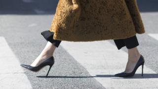 Женщина на высоких каблуках