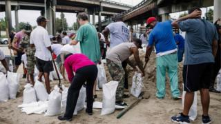 People fill sandbags as they prepare for Hurricane Nate in New Orleans, 7 October 2017