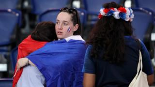 French fans after their loss to the USA