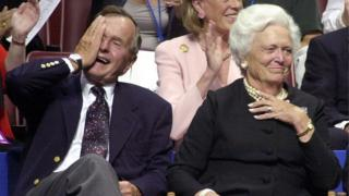 Former US President George H W Bush accompanied by former US First Lady Barbara Bush, during the evening session of the 2000 Republican National Convention in Philadelphia's First Union Center 31 July, 2000.