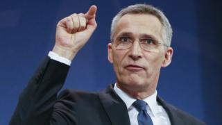 Secretary General Jens Stoltenberg stresses a point as he speaks during a news conference at the NATO headquarters in Brussels, Belgium
