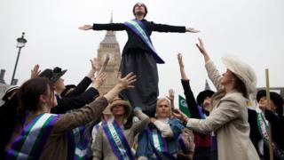 "October 24, 2012: Feminist activists dressed as The Suffragettes, women who historically demanded the right to vote, protest at Parliament Square for women""s rights and equality in Parliament Square, London"
