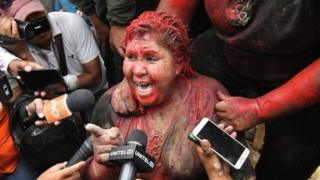 Patricia Arce speaks to the media after being attacked by a crowd that sprayed her with reddish paint and cut her hair in Vinto, Bolivia, 06 November 2019