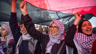 Moroccan women hold up a flag at a demonstration against the US Middle East peace plan in Rabat, Morocco - Sunday 9 February 2020