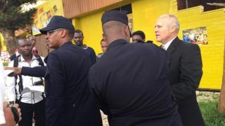 Gregg Schoof is arrested in Kigali