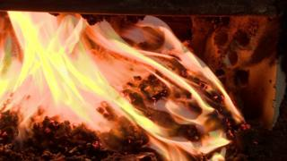 Burning wood pellets in a biomass boiler