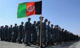 Members of the Afghan National Police (ANP) attend a graduation ceremony at a police training centre in Herat on September 26, 2013.