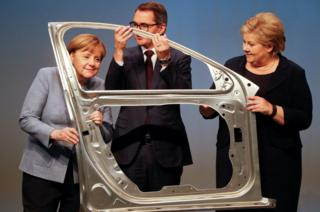 German Chancellor Angela Merkel, Svein Richard Brandtzaeg, President and Chief Executive Officer of Rolled Products and Norwegian Prime Minister Erna Solberg are seen during the official opening of a production line
