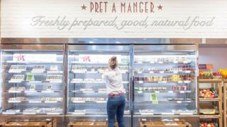 A staff member at Pret a Manger