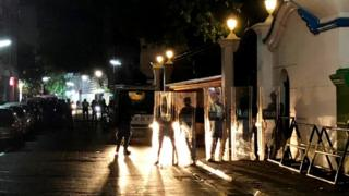 Security forces stand guard outside the Supreme Court in Male, Maldives, 5 February