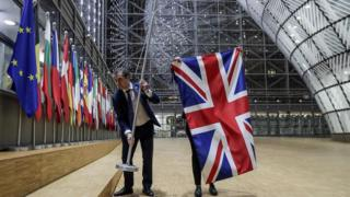The UK flag is removed from the European Council building in Brussels.
