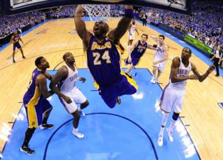 Kobe Bryant dunks the ball against Oklahoma City Thunder in Oklahoma City, 2012.