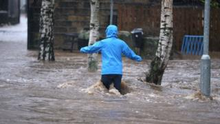 A person in flood water