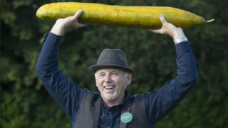 Graham Barratt with his winning giant cucumber that is 920mm long, after he scooped 1st prize