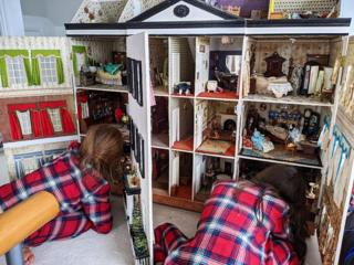 Children with a dolls house