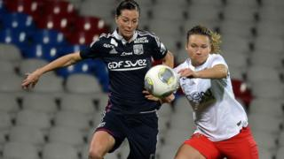 Paris Saint-Germain and Lyon in the women's Champion's League competition in 2014