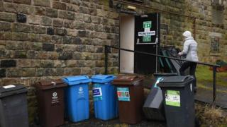 Bins outside a polling station in Diggle, Greater Manchester