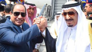Egyptian President Abdel Fattah al-Sisi shakes hands with Saudi King Salman as he prepares to leave Cairo on 11 April 2016