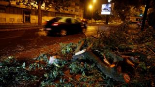 Branches of trees are seen on a street storm Leslie goes past in Lisbon, Portugal October 14, 2018.