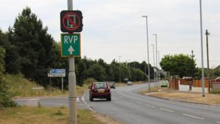 Mobile phone warning road signs 'a UK first'