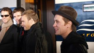 Members of the band Take That use the Eurostar in 2008