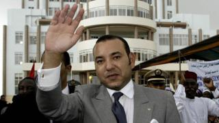 King Mohammed VI of Morocco greets the crowd