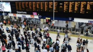 commuters at Waterloo Station in London.