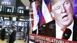 Donald Trump on a trading floor TV screen
