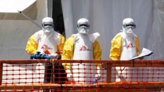 Health workers wear protective suits for one Ebola treatment centre inside DR Congo