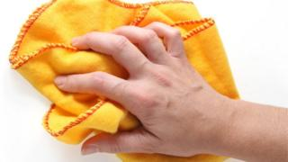 A hand using a duster