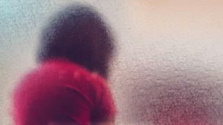Child behind blurred glass