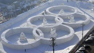 This photo taken February 4, 2017 shows the snow sculpture shaped of the Olympic rings at the town of Hoenggye
