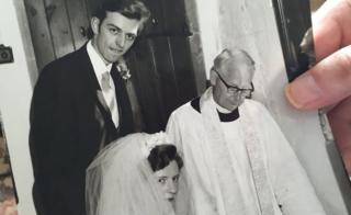 Freda and Brian Cooke and the vicar