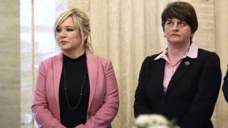 Sinn Fein leader Michelle O'Neill stands alongside DUP leader Arlene Foster
