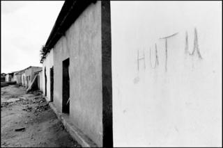 "A wall with the word ""Hutu"" written on. Hutus living in this house scrawled their ethnicity on the wall to prevent looting"